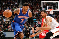 Carmelo Anthony Photos - Carmelo Anthony #7 of the New York Knicks drives against Thabo Sefolosha #25 of the Atlanta Hawks at Philips Arena on January 5, 2016 in Atlanta, Georgia.  NOTE TO USER User expressly acknowledges and agrees that, by downloading and or using this photograph, user is consenting to the terms and conditions of the Getty Images License Agreement. - New York Knicks v Atlanta Hawks