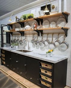 7 Favorite Kitchen & Bath Trends Fabulous La Cornue kitchen with open shelving, brass pot rack, swing-arm sconces, and cabinets with pull-out baskets Kitchen Redo, Home Decor Kitchen, Interior Design Kitchen, Home Kitchens, Kitchen Remodel, Kitchen Storage, Open Cabinet Kitchen, Open Kitchen Shelving, Kitchen Black