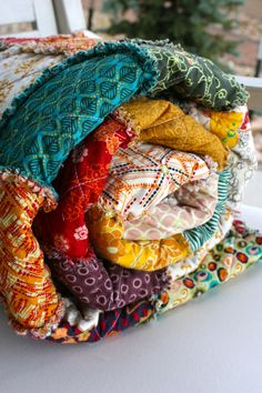 Rag Quilt. Love all the colors! Perfect to bring in lots of colors in the room.