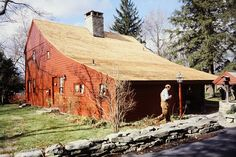 A SALTBOX is a building with a long, pitched roof that slopes down to the back, generally a wooden frame house. A saltbox has just one story in the back and two storeys in the front. The flat front and central chimney are recognizable features, but the asymmetry of the unequal sides and the long, low rear roof line are the most distinctive features of a saltbox, which takes its name from its resemblance to a wooden lidded box in which salt was once kept.
