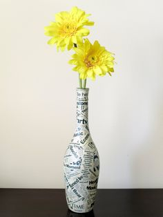 Decoupaged #Wine Bottle...save a wine bottle from a special occasion and wrap with something related to it.  For example, bottle from engagement celebration wrapped with extra copies of your wedding announcements or programs, etc