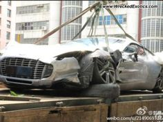 This is the first known wreck of the Aston Martin One-77, a $1,900,000 super exotic.    Driver hit a curb at high speed. The car had just recently been delivered to the owner.