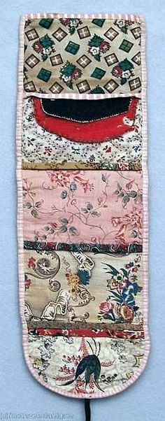 """One of the finest & earliest examples of an American housewife. Circa 1830 roll up - 14"" x 4-1/2"", all hand sewn, five interior pockets, each with different calico print, each bound with various calicos, two wool needle flaps, black ties, bound in pink checked cotton and early calico print on exterior. De-accessioned from a New York state museum.)"""