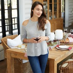 Stay comfortable & stylish this holiday season with an on-trend cold shoulder sweater & skinny jeans with the perfect wash.