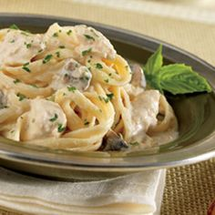 Chicken and Mushroom Fettucccini Alfredo recipe. Slow cooker / thermal cooker. Chicken, cream cheese, Parmesan cheese, milk, mushrooms. No canned soup.