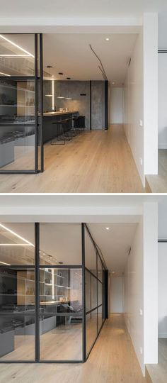 Black framed glass walls can be used to close off this modern kitchen from the other spaces of the penthouse when needed.