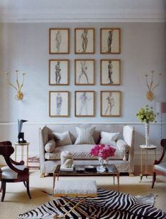 The grid of portraits above the sofa in this living room is beautiful. | Ideas that I wouldn't come up with myself