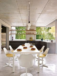 Ross House by Antonio Zaninovic | Home Adore.  Shelves against the windows.  Color and shape of kitchen cabinets.