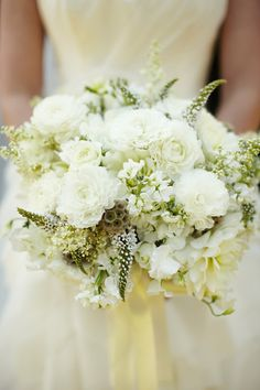 White bridal bouquet of ranunculus, scabiosa, loosestrife, and seasonal blooms. Wedding flowers by Fiore Blossoms via Fiore fresco; Photos by Sarah Rhoads Photography