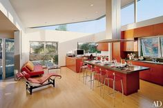 Architect Dean Nota updated the bright Venice, California, kitchen of Architectural Digest contributing photographer Erhard Pfeiffer, which includes BABA leather barstools from Design Centro Italia and a KitchenAid cooktop and hood above the island.