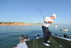 Portugal Master 2012 - Venue  Via European Tour   Tom Lewis, defending champion plays a shot from the boat to a target on a small boat prior to the start of the Portugal Masters on October 9.  #Portugal