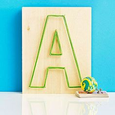 See how to make a simple piece of string art with your child's initial!