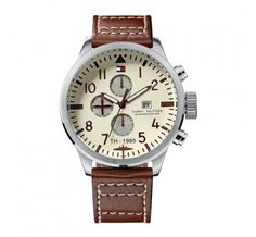 Deck yourself out with dateless style. This Tommy Hilfiger watch features a brown leather strap and round stainless steel case. Ivory dial with brown numerals, logo, date window and three subdials. Movado Mens Watches, Gents Watches, Fine Watches, Cool Watches, Watches For Men, Fossil Watches, Brown Leather Watch, Leather Watch Bands, Tommy Hilfiger Watches