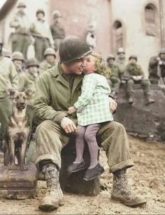 same in colorized version, but not the same comment: US Army Signal Corp Photo Tec-4, Elvin Harley getting a kiss from a French child, while listening to the US 9th Armored Division Band near Aboncourt in the Moselle department of Lorraine in North East