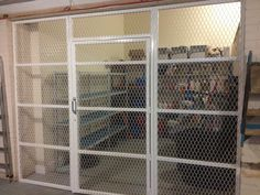 cage fitted in a store room in a commercial building in Middlesex. Offices, Cage, House Plans, Commercial, Store, Spring, Building, Fabric, Room