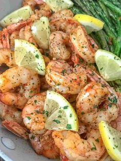Lemon Garlic Butter Shrimp with Asparagus - this is an easy, light and healthy dinner option that is cooked in one pan and can be on your table in 15 minutes. Buttery shrimp and asparagus flavored with lemon juice and garlic. Only 309 calories per serving Shrimp Recipes For Dinner, Shrimp Recipes Easy, Seafood Recipes, Cooking Recipes, Healthy Recipes, Healthy Food, Lemon Recipes Dinner, Vegan Food, Healthy Hair
