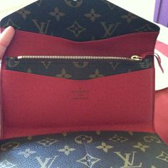 LV wallet. Love the touch of red n removable coin purse.