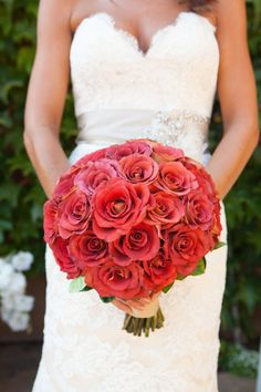 Romantic red rose bouquet: http://www.stylemepretty.com/california-weddings/sonoma/2014/05/22/colorful-viansa-winery-wedding/ | Photography: Jen Philips - http://www.jenphilips.com/