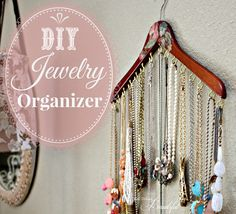 DIY Jewelry Organizer from a wood hangar and cup hooks to organize those statement necklaces.  Decoupage fabric or paper on the hangar to match your decor. ~By Janis at All Things Beautiful  Part of Operation: Organization 2014 at 11 Magnolia Lane.  We've got nine days of blog posts that are designed to help you get your New Year's organizing kick-started.  Every day features a different talented blogger, sharing her best tips and projects with you.
