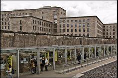 ღღ Berlin, Kreuzberg - Open air museum of Topography of Terror, in Berlin, that shows the city's history from 1933 till 1989. Behind the panels is the second largest section of the Wall and the Ministry of Aviation of the Reich, one of the three buildings that still stand from the Nazi age.