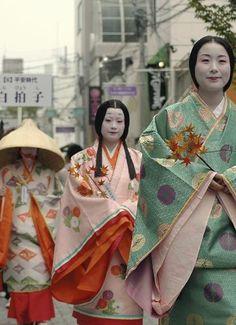 Women wearing junihitoe for a parade.