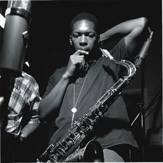 Francis Wolff photo of John Coltrane  listening to a take from the Blue Train Session, 09/15/57