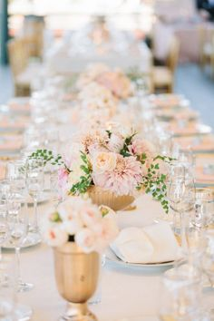 gorgeous wedding flowers on table I love the gold vases this is exactly what I am thinking for table scapes