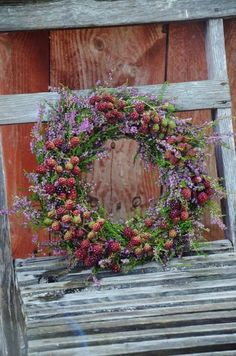 Gorgeous wreath incorporating blacberries, foliage and heather. natural flower arrangement. Autumn winter wedding flowers florals decoration backdrop red purple green