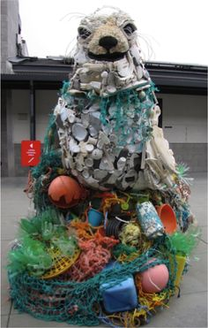 Washed Ashore: From Beach Trash to Ocean Art | Lidia the Seal sits on top of a pile of netting, rope and buoy. The sculpture itself is colorful and playful—but opens up the conversation to how discarded plastics and trash can harm marine life like seals
