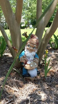 Garden Gnome Painting Mushrooms Under the Crepe Myrtle