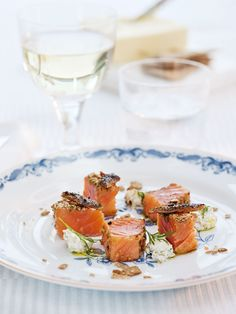 Cured rainbow trout served blackened w/ mustard and cream cheese cream w/ crumbs on crisp bread