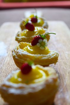 Elderflower curd tarts topped with a sweet wild strawberry.