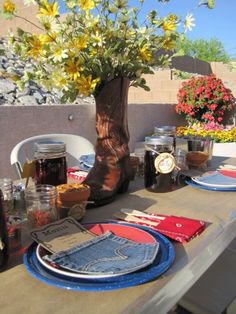 Daisies in cowboy boots for table centerpieces (or other decoration). I also really like the denim pocket, for menu, napkin, program or whatever.