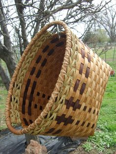Rectangle Laundry Lugger woven in brown - handwoven laundry basket - stained using my own stain made from pecan shells -. $85.00, via Etsy.