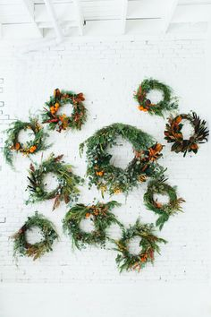 Moon Canyon Wreath Workshop: start with a type of cedar and/or eucalyptus and then add accents from there, i.e. persimmons, artichokes, dried lotus pod, so on...