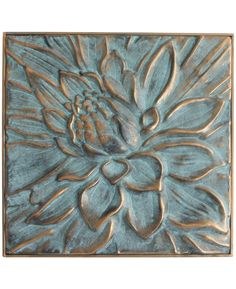 Metallic lotus relief finished with rich green and blue patina hues. Suitable for indoors or outdoors.