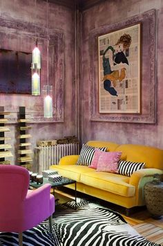 Great use of colour and pattern. Complementary colours purple and yellow really make the lounge pop!
