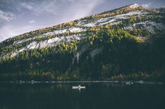 kayaking in fall. by Johannes Hoehn