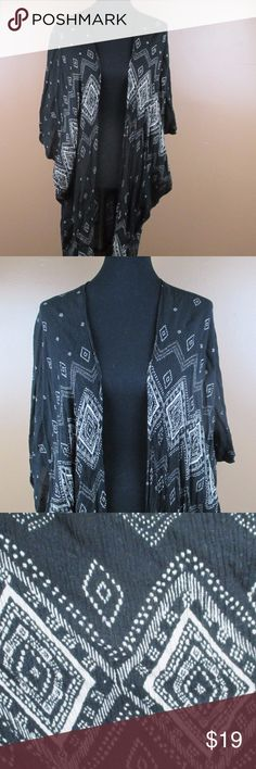 L/XL Lush Kimono Black Lush Kimono This Kimono is very oversized, can fit up to a size XL Super easy to style 40 inches long at the longest part of the kimono which is the back  ***Offers Accepted***  Add to a bundle for an automatic discount!!!  Colors may very due to lighting, seller does its best to portray the right color.  Please inspect all photos.  #G024 Lush Sweaters Shrugs & Ponchos