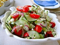 Cucumber, Tomato  Feta Salad... could be made into a pasta salad, too. Great for 4th of July Parties!