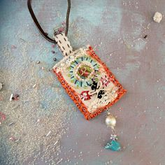 Handmade Fabric Pendant in Orange Blue and White with by MooAndRoy