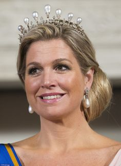 Queen Maxima of The Netherlands, also celebrating a state visit from the Chinese, this tim...