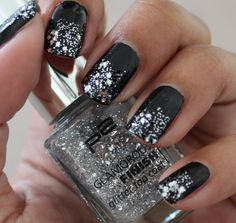 black nails with glitter finish