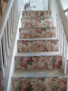 distressed treads with floral wallpaper  risers.