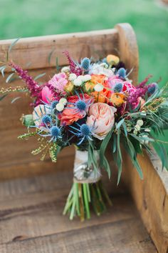 Barbara and Eric showed Lush Floral photos of wild and colorful blooms and let them do what they do best. Her bouquet incorporated vibrant peonies, garden roses, thistles, ranunculus, roses, astilbes and dahlias with messy greenery.