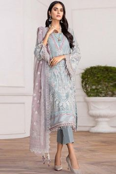 Cast a spell with this light blue georgette trouser suit which will lure the audience like never before. This round neck and full sleeve attire elaborated using sequins,stone work and thread work. Accompanied by a matching santoon cigarette pants in light blue color with light purple net dupatta. Cigarette pant is plain. #trousersuit #salwarkameez #malaysia #Indianwear #Indiandresses #andaazfashion Pakistani Salwar Kameez, Salwar Suits, Pantalon Cigarette, Kurti Designs Party Wear, Printed Trousers, Trouser Suits, Indian Dresses, Designer Wear, Indian Wear