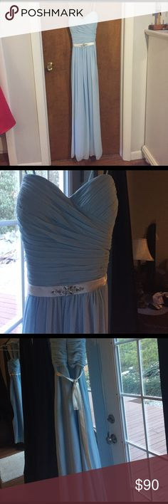 Baby blue floor length dress Beautiful light/baby blue floor length dress. Worn ONCE as a bridesmaids gown but can be used for a prom or any spring/summer event! Dress is in great condition but has some little spots. Sewn in cups for support. The back has a beautiful long silk tie. Sweetheart neckline. Small rhinestone detail on the belt below the chest. Side gathered waistline. Selling as is. Can remove straps to make strapless. Or halter. Bill Levkoff Dresses Prom