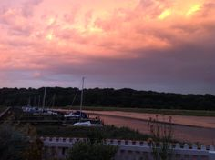 The fiery glow of summer storms over the salt marshes of Essex