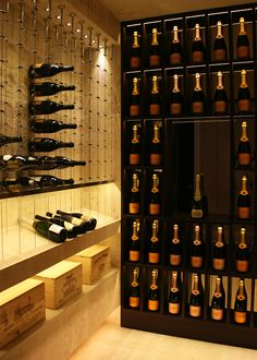 Travertine wine and Champagne cellar featuring the Cable Wine System.