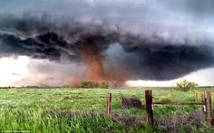 Menacing tornado strikes farmland in rural Colorado.